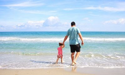 Fathers Day with dad and daughter on a beach