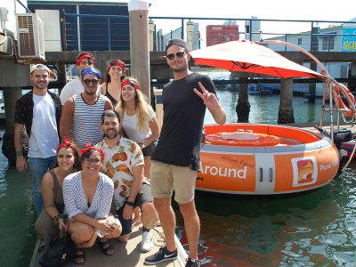 10 People about to jump on a orange round boat
